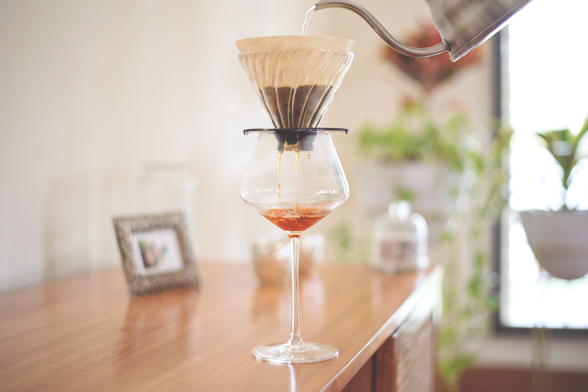 Coffee brewing into a wine glass