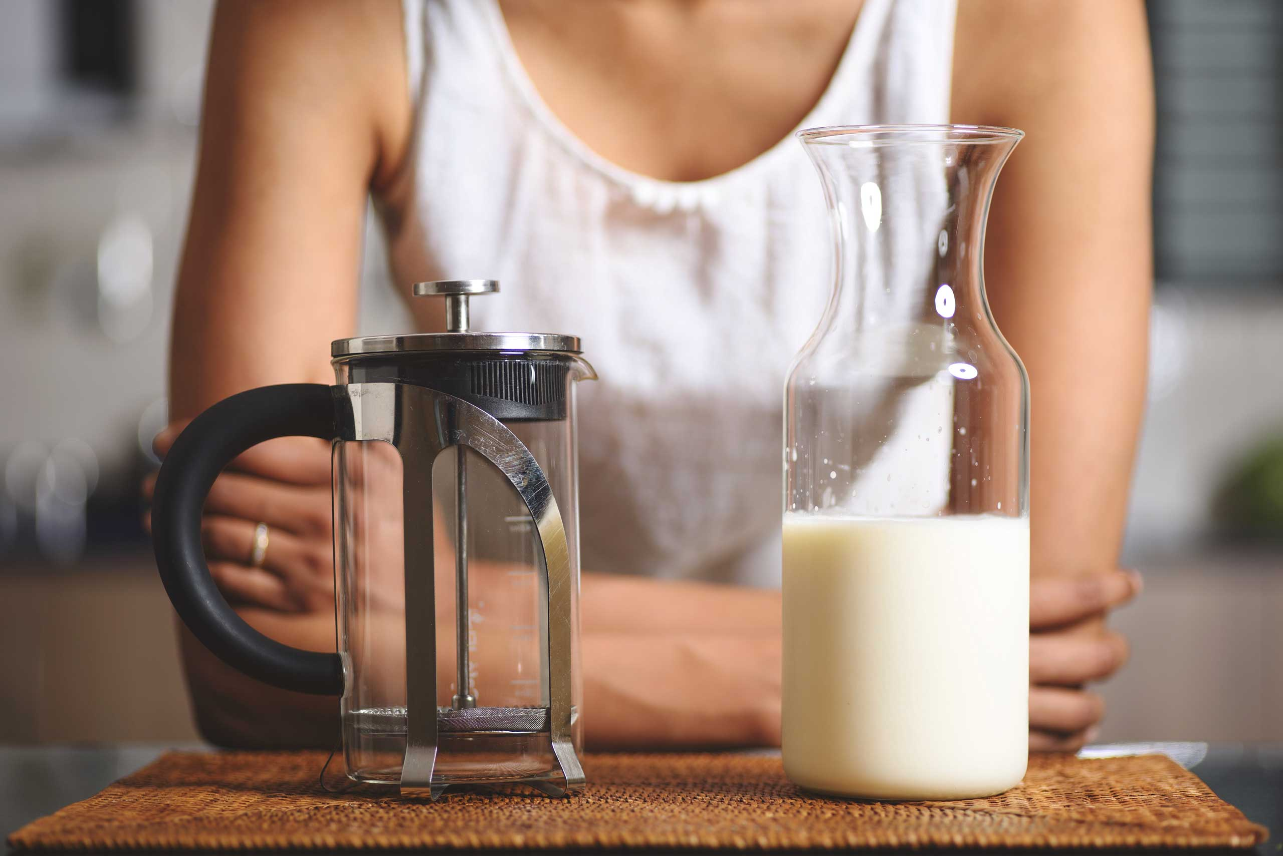 French press and milk bottle